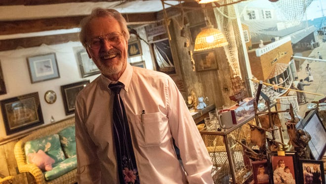 William Hoffmeyer laughs while recalling some of his old sailing stories in his office, Wednesday, June 27, 2018. William Hoffmeyer has had an obsession with ships since he was a little kid. His building, which doubles as his living space and law office, has three floors of nautical memorabilia.