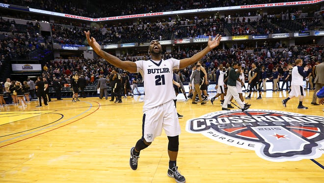 Butler Bulldogs forward Roosevelt Jones (21) celebrates with fans after the team's win against the Purdue Boilermakers during the Crossroads Classic at Bankers Life Fieldhouse Dec. 19, 2015.