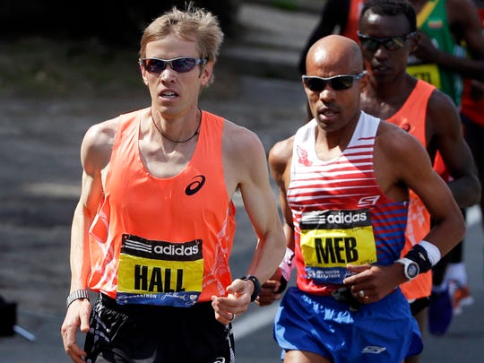 Ryan Hall of Redding, Calif., leads eventual winner Meb Keflezighi of San Diego on Monday during the 118th Boston Marathon. Keflezighi is the first American man to win the event since 1983.
