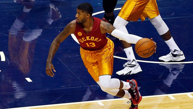 """Paul George dons a burgundy and gold Hickory jersey, inspired by the movie """"Hoosiers,"""" during Friday's game at Bankers Life Fieldhouse. George finished the night with 36 points."""