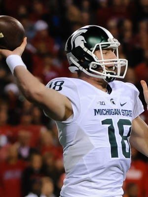 Nov 7, 2015; Michigan State Spartans quarterback Connor Cook (18) throws the ball against the Nebraska Cornhuskers at Memorial Stadium.