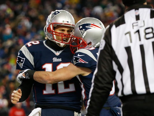 New England Patriots quarterback Tom Brady (12) celebrates his touchdown run with New England Patriots wide receiver Danny Amendola (80) in the first half of an NFL divisional playoff football game against the Baltimore Ravens Saturday, Jan. 10, 2015, in Foxborough, Mass. (AP Photo/Elise Amendola)