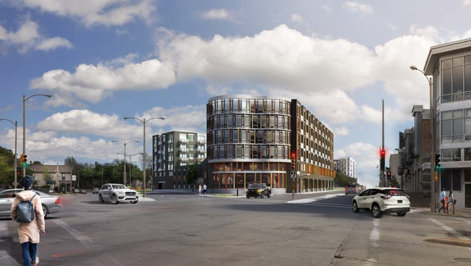 A six-story, 144-unit apartment building would be developed in Bay View under a proposal approved by a Milwaukee Common Council committee.