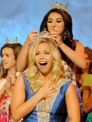 Miss Ohio 2014 Mackenzie Bart crowns Miss Maple City Sarah Hider, of Wooster, as the 2015 Miss Ohio on Saturday night during the Miss Ohio Scholarship Program at the Renaissance Theatre in Mansfield.