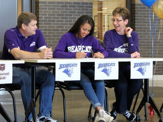 Kickapoo senior Laura Vierkant (center), surrounded by her parents, signed a letter of intent to play basketball for Southwest Baptist University upon graduating from Kickapoo High School.