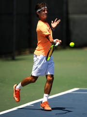 Jaycer Lyons, from Houston, returns a ball during his match against Roger Chou in the Boys' 18 singles division of USTA Texas Grand Slam on Wednesday, June 14, 2017, at the Streich Tennis Center.