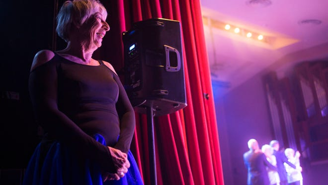 Sue Carpenter gleefully watches the show from the wings during the rehearsal for Name That Tune on Wednesday in Anderson.