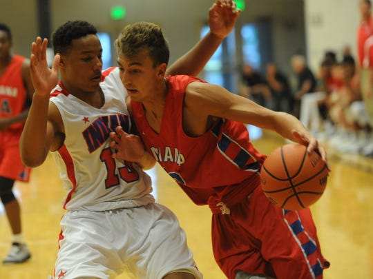 Desmond Bane of the Indiana All-Stars defends against Parker Hazen of the Junior All-Stars during Thursday's game at Lebanon.