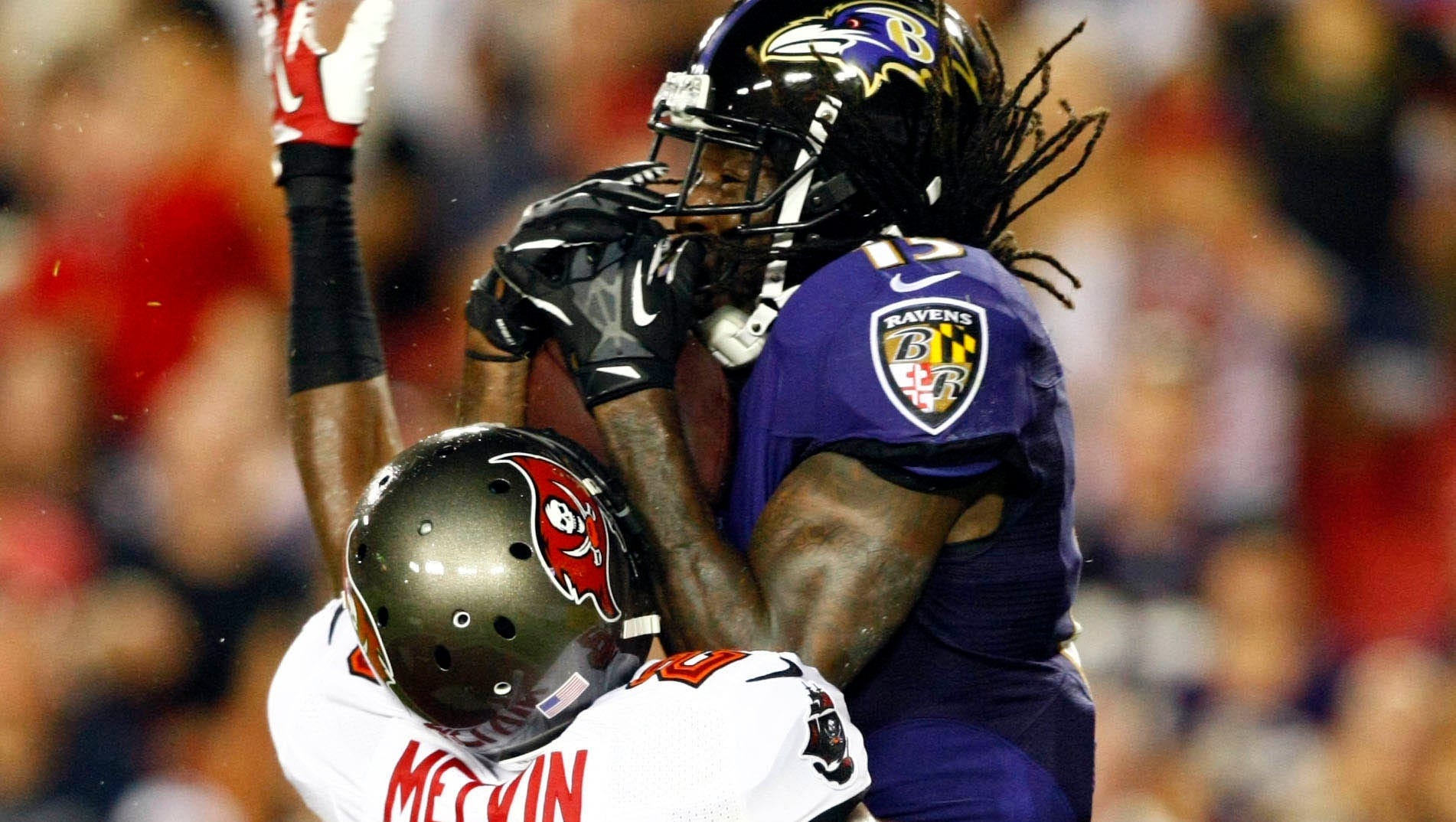 Baltimore Ravens wide receiver LaQuan Williams (15) makes a touchdown reception over Tampa Bay Buccaneers defensive back Rashaan Melvin (28) during the third quarter at Raymond James Stadium.
