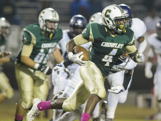 Crowley running back Ty'Von Griffin (4) runs with the