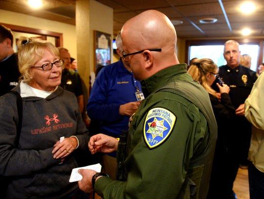 Phyllis Ryan talks with Jim Humiston of the Montana