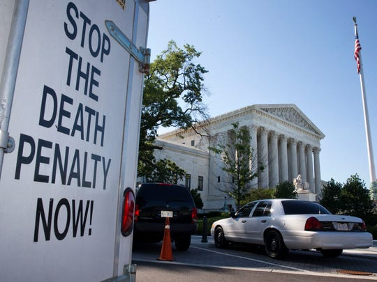 "A vehicle parked near the Supreme Court displays a sign that says ""Stop The Death Penalty Now"" on June 29, 2015."