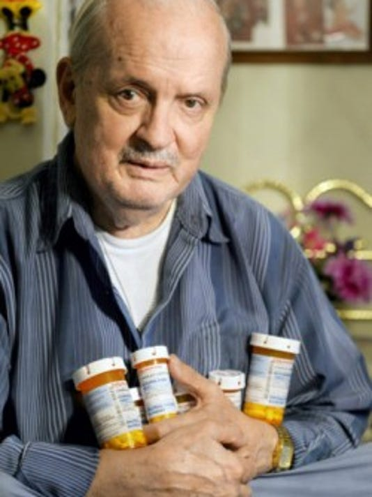 Charles Sweitzer, 77 of York stands for a portrait Thursday in his York Towne House apartment holding the medications he takes for high blood pressure, high cholesterol and Type 2 diabetes. Sweitzer receives a low-income subsidy from Medicare Part D to help pay for his six prescriptions, which cost him about 10 a month. According to data obtained by ProPublica, in 2011, about 85 percent of Medicare Part D claims for zip code 17401 were for LIS enrollees -- more than 30 percent higher than the national average. (Chris DUnn -- Daily Record/Sunday News)