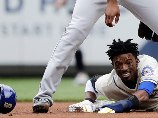 Seattle Mariners' Dee Gordon reacts below Detroit Tigers second baseman Niko Goodrum after losing his helmet on a slide as he was forced at second during the first inning of a baseball game, Sunday, May 20, 2018, in Seattle. (AP Photo/Ted S. Warren)