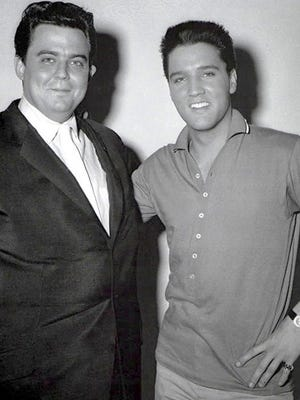 "Lamar Fike (left) worked with Elvis Presley from 1954, before Presley's first recordings at Sun Studios in 1954, until Elvis' death in 1977.  Fike and Presley are shown here in April 1960 at RCA Studios in Nashville, where Presley was recording the soundtrack to ""G. I. Blues.""  The friendship between the two men is chronicled in ""Elvis: Truth, Myth & Beyond,"" recently published by Hound Dog Books & Media, based in Woodbridge."