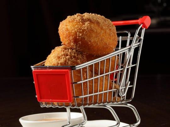 Fresh doughnuts presented in a mini shopping cart at