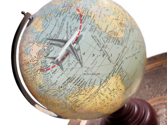 Travel Flying Concept. Model Airplane Vintage Globe. Transatlantic Vacation Destination