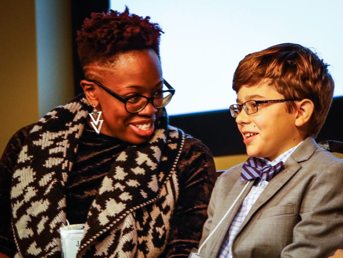 Jantrice Johnson chats with fellow spelling bee competitor