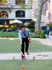 Playing Kubb at Bryant Park