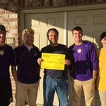 From left to right: Myles Kendrick, Student Council President Jake Roseberry, Homes of Hope's Robert Litke, Ian Vowell, Madison Seymour