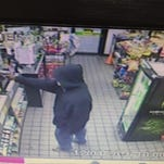 Suspect sought in robbery of service station