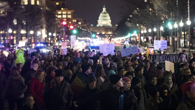 Protestors and LGBT activists march toward the White House after rallying outside of Trump International Hotel, February 3, 2017 in Washington, D.C. The protest was organized by the group 'WERK for Peace,' and they aimed to let President Trump know 'discrimination, bigotry, and hate are not tolerated in our country.'
