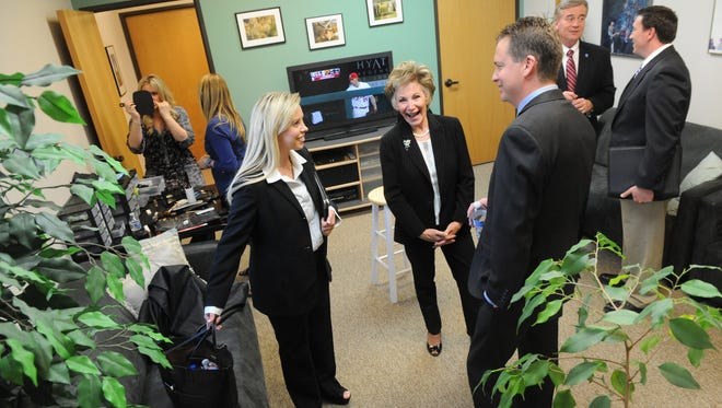 A group of Reno mayoral candidates relax and chat prior to going out for the opening debate Thursday evening at KNPB Studios.