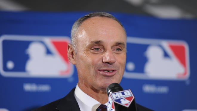 Rob Manfred, Bud Selig's chief operating officer, to become the game's 10th commissioner.