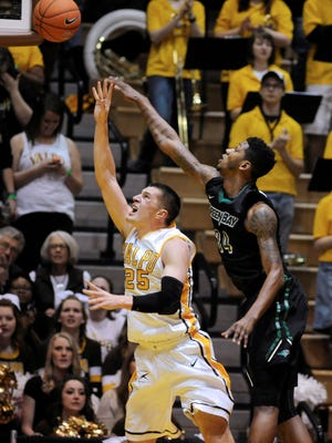 Valparaiso forward Alec Peters (25) puts a shot up in front of Green Bay forward Alfonzo McKinnie  in the first half of an NCAA college basketball game in the championship of the Horizon League conference tournament, Tuesday, March 10, 2015, in Valparaiso, Ind. (AP Photo/Joe Raymond)