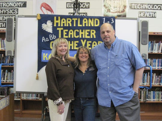 Hartland Consolidated School Teacher of the Year Karen Condra receives congratulations from Superintendent Janet Sifferman and Hartland Middle School at Ore Creek Principal Steve Livingway.