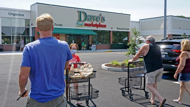 Shoppers come and go at the new Dave's Market on West Shore Road in Warwick, at the site of a former Benny's store.