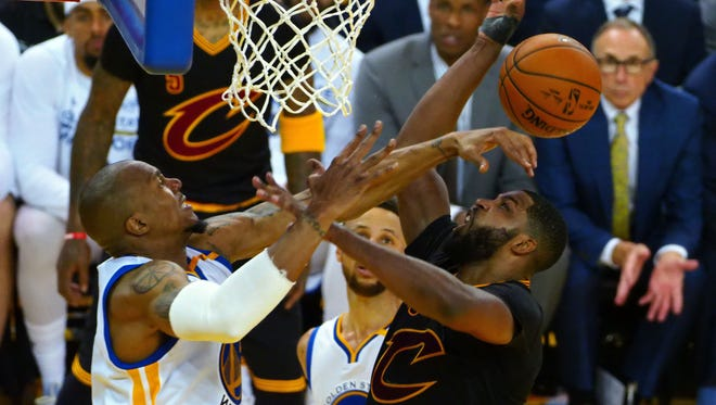 Cleveland Cavaliers center Tristan Thompson (13) shoots the ball against Golden State Warriors forward David West (3) during the fourth quarter in Game 5 of the 2017 NBA Finals at Oracle Arena.