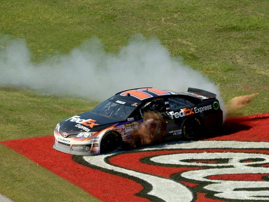 NASCAR Sprint Cup Series driver Denny Hamlin (11) celebrates winning the Aaron's 499 at Talladega Superspeedway.