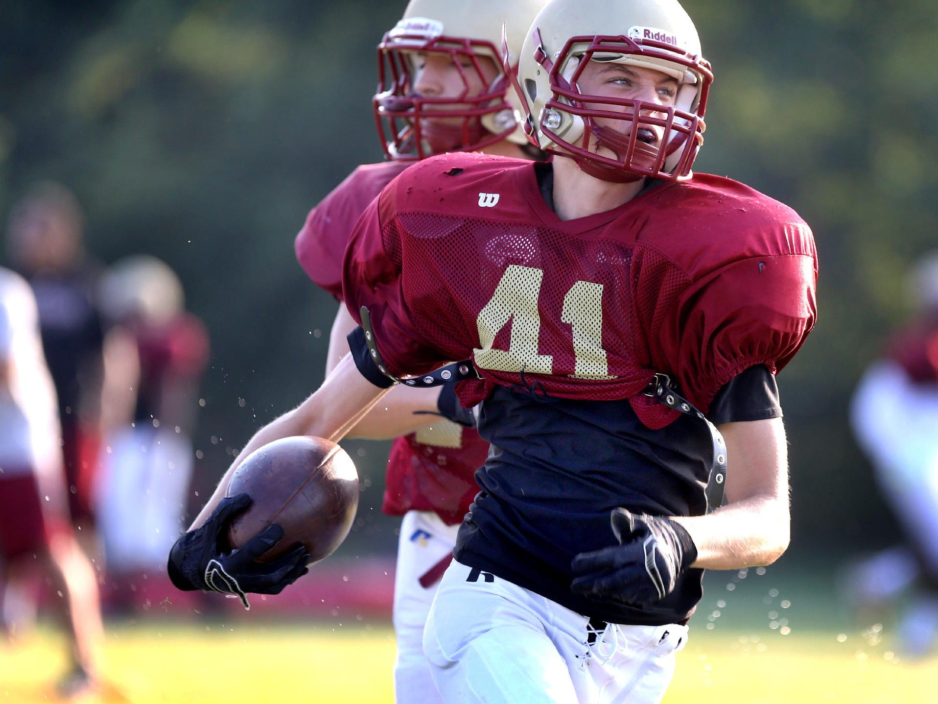 Riverdale's Michael Bennett runs the ball during the school's first day of pracitce with pads on Monday July 28, 2015.