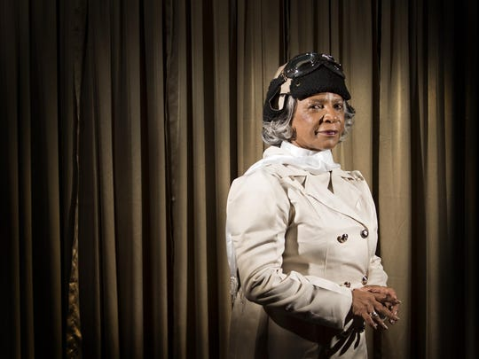 Sharon Moore poses for a portrait in her home dressed as Bessie Coleman, the first African American female aviator, on Tuesday evening.
