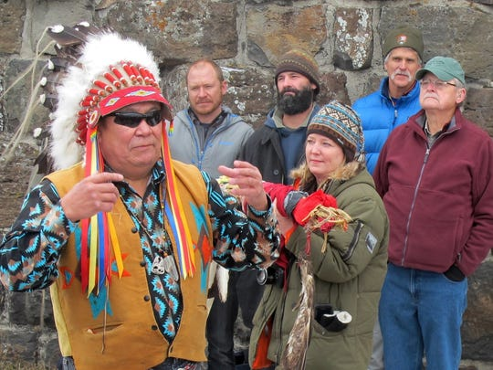 Jimmy St. Goddard, left, a spiritual chief for the Blackfeet Tribe, talks as individuals involved in wolf reintroduction.