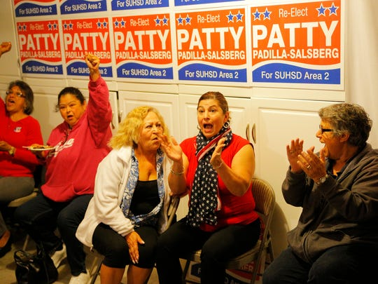 Patty Padilla-Salsberg, center, reacts after listening to her election results at her home in Salinas on Tuesday.