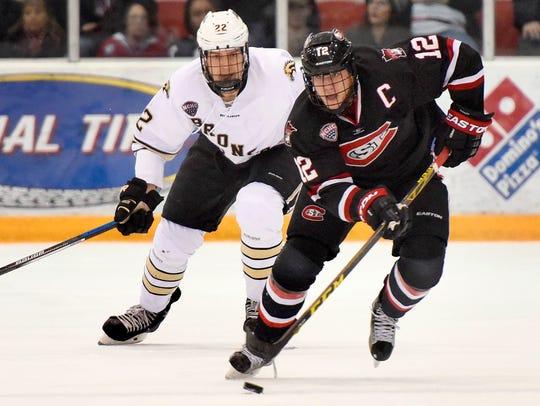 St. Cloud State's Ethan Prow skates toward the goal