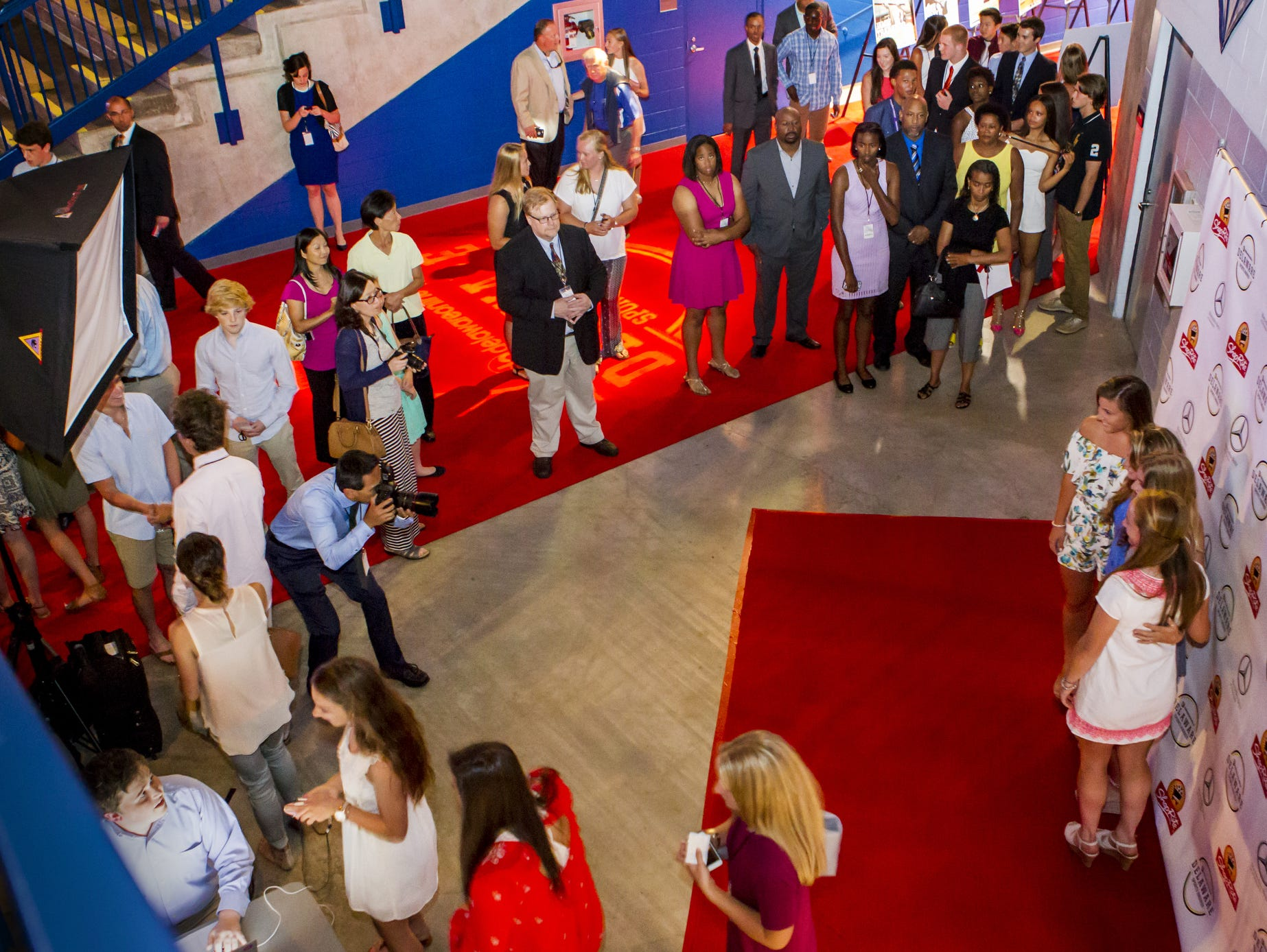 Guests at the Delaware Sports Awards banquet get photos taken along the red carpet at the Bob Carpenter Center at the University of Delaware in Newark on Wednesday evening.
