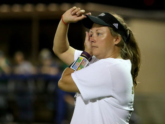 Rider head coach Alisha Crouch stands at third in the