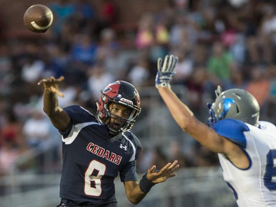 Lebanon quarterback Zakee Sailsman fires a pass downfield during the annual Cedar Bowl last year.