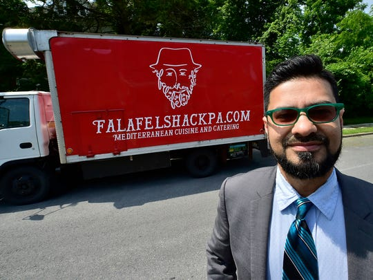 Amer Chaudhry stands near his food truck on Thursday, June 7, 2018. Chaudhry and his wife, Jasmina Ademovic, will open Falafel Shak at 9 N. Main Street, at Memorial Square, Chambersburg.