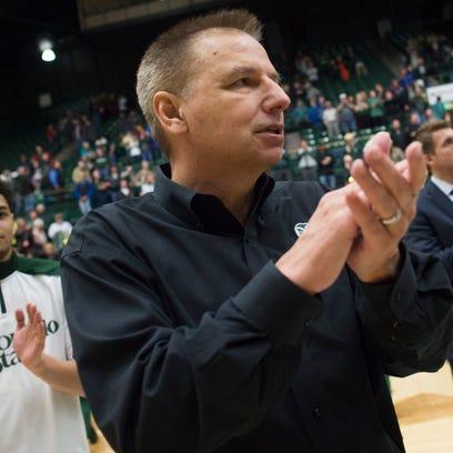 CSU men's basketball  coach Larry Eustachy celebrates