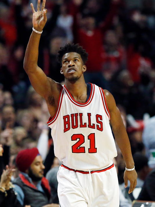 Chicago Bulls guard/forward Jimmy Butler reacts after hitting a 3-point shot against the Milwaukee Bucks during the first half of an NBA basketball game Saturday, Dec. 31, 2016, in Chicago. (AP Photo/Nam Y. Huh)