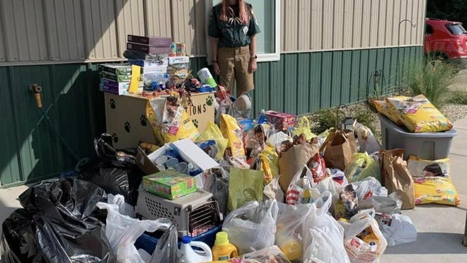 Emily Smit, Geneseo, a member of Venture Crew 325 of Moline, is shown with the items collected in a recent fundraiser held for the Henry County Humane Society. Smit organized the project as part of her work in earning the Scouts Summit Award.