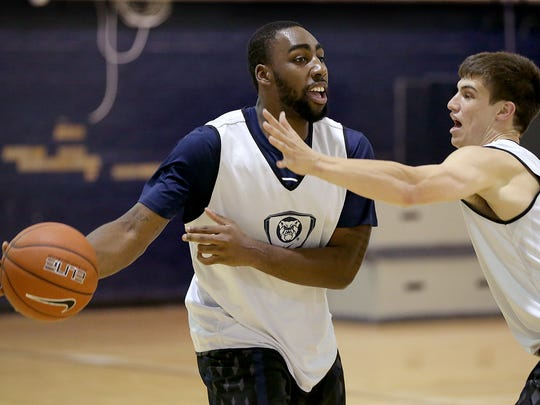 Butler Men's Basketball player Roosevelt Jones is back and eager to play after being sidelined last year with a wrist injury. Here Jones passes around Kellen Dunham during practice.