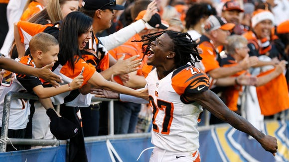 Cincinnati Bengals cornerback Dre Kirkpatrick (27) celebrates with the many fans that came to cheer their team to a 17-10 win against the San Diego Chargers at Qualcomm Stadium.