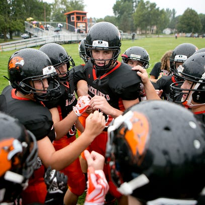 The Port Edwards football team huddles up before a non-conference football game against North Crawford at John Edwards High School, Friday, Aug. 28, 2015.