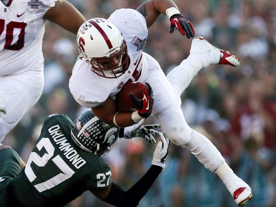 Stanford running back Tyler Gaffney gets tackled by