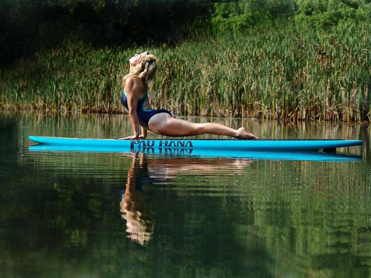 Dyhanne Neuens makes paddleboard yoga look easy. Others can give it a try on Fowler Lake in Oconomowoc.